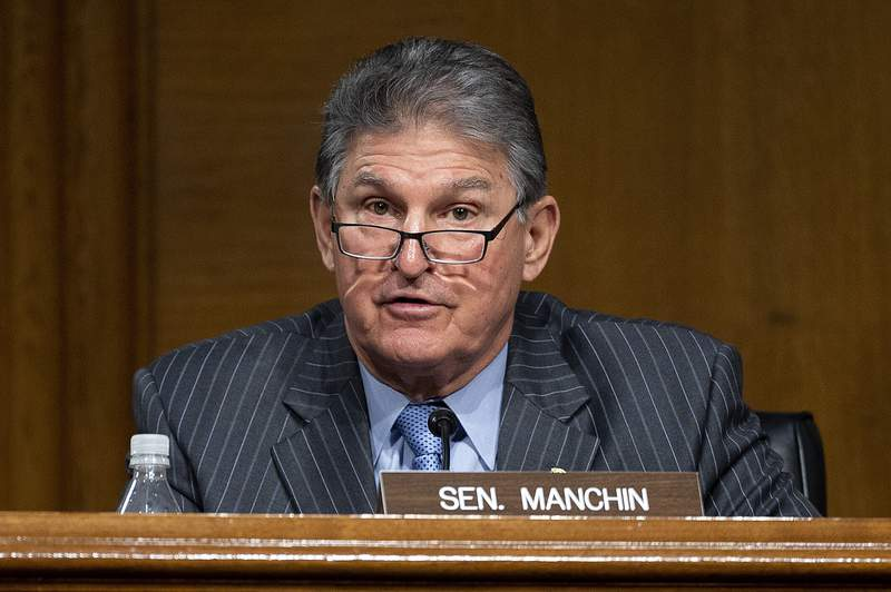Committee Ranking Member Sen. Joe Manchin, D-WVa., speaks during a hearing to examine the nomination of former Gov. Jennifer Granholm, D-Mich., as she testifies before the Senate Energy and Natural Resources Committee during a hearing to examine her nomination to be Secretary of Energy, Wednesday, Jan. 27, 2021 on Capitol Hill in Washington. (Jim Watson/Pool via AP)