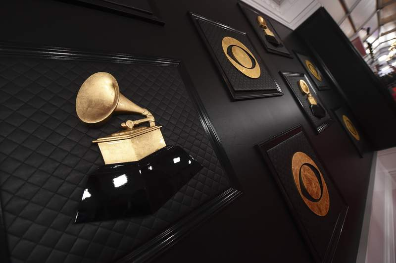 FILE - The red carpet appears prior to the start of the 62nd annual Grammy Awards in Los Angeles on Jan. 26, 2020. The Grammys are changing the name of its best world music album category to the best global music album, an attempt to find a more relevant, modern and inclusive term. The Recording Academy said the new name symbolizes a departure from the connotations of colonialism. The step comes some five months after the Academy made changes to several Grammy Awards categories, including renaming the best urban contemporary album category as best progressive R&B album.  (Photo by Jordan Strauss/Invision/AP, File)