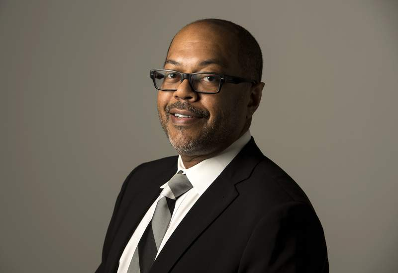 This image released by ESPN shows Kevin Merida in Bristol, Conn., on Jan. 12, 2016. The Los Angeles Times said Merida will be its new executive editor. Merida has run ESPN's The Undefeated site, which deals with issues on race and culture along with sports. He's had extensive newspaper experience, including 22 years at The Washington Post. (Joe Faraoni/ESPN Images via AP)