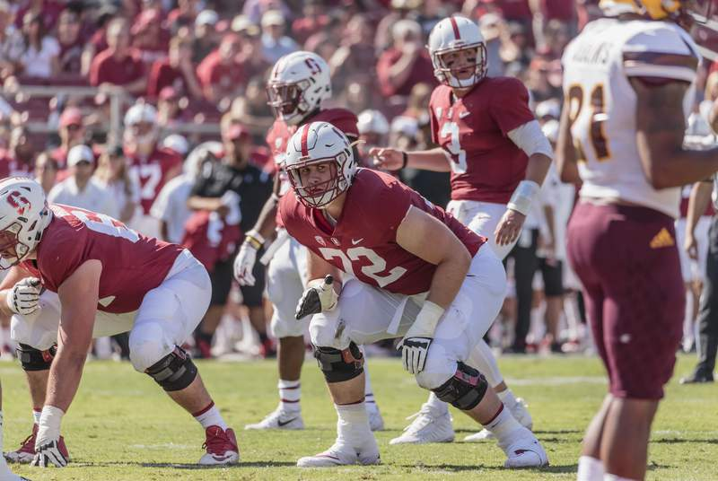 Offensive tackle Walker Little of the Stanford Cardinal waits for the snap during an NCAA Pac-12 football game against the Arizona State University Sun Devils on September 30, 2017 at Stanford Stadium in Palo Alto, California.   Visible behind Little are Bryce Love #20 and quarterback K.J. Costello #3 of Stanford.  (Photo by David Madison/Getty Images)