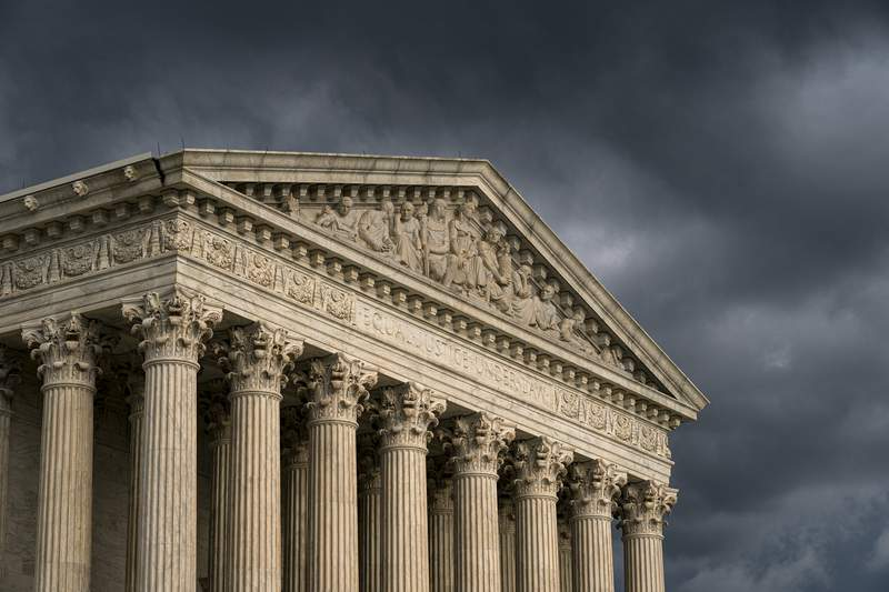 FILE - In this June 20, 2019, file photo, the Supreme Court is seen in Washington as a storm rolls in.  (AP Photo/J. Scott Applewhite, File)