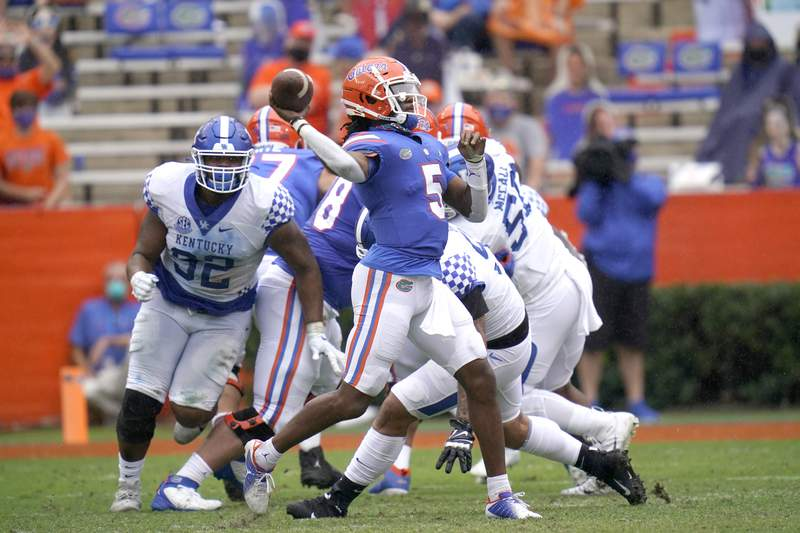 Florida quarterback Emory Jones (5) throws a pass during the second half of an NCAA college football game against Kentucky, Saturday, Nov. 28, 2020, in Gainesville, Fla. (AP Photo/John Raoux)