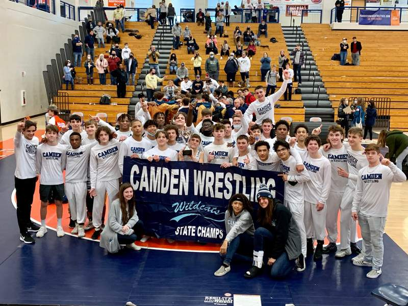 Members of the Camden County wrestling team celebrate winning their seventh consecutive state championship on Jan. 30, 2021.