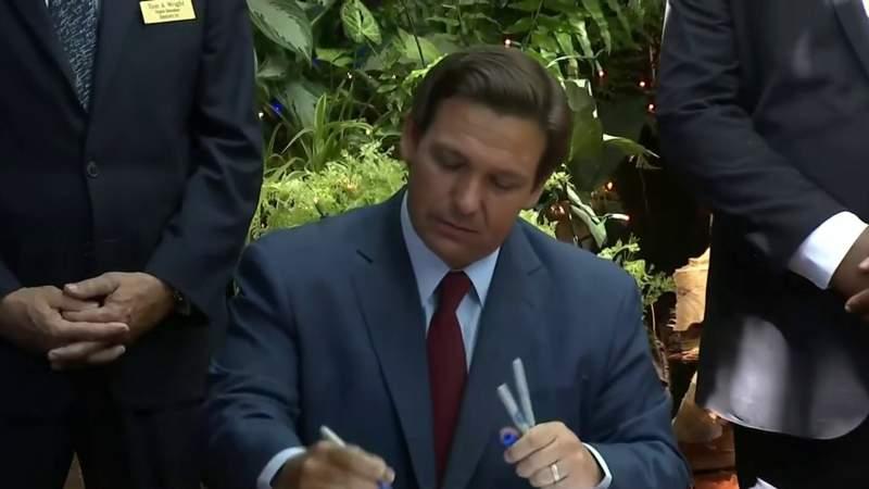 Gov. DeSantis signs state budget at The Garlic restaurant in New Smyrna Beach.