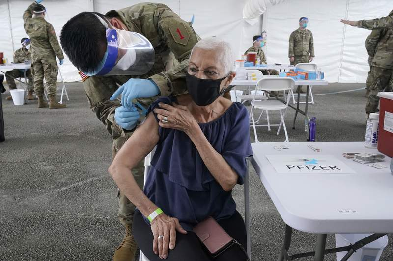 Ivonne Burgess, 81, gets the first dose of the Pfizer COVID-19 vaccine at a FEMA vaccination site at Miami-Dade College, Wednesday, March 3, 2021, in North Miami, Fla. (AP Photo/Marta Lavandier)