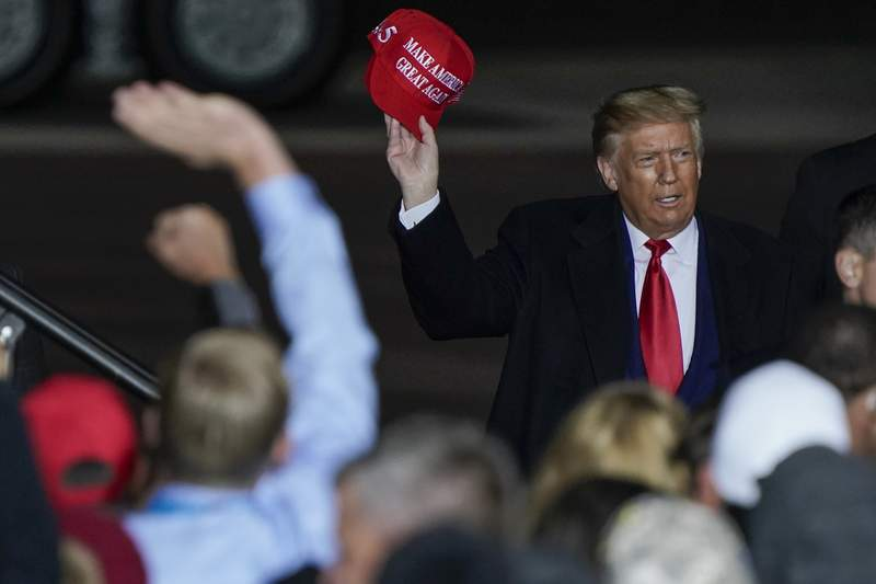 President Donald Trump throws a hat to the crowd after speaking at a campaign rally at the Central Wisconsin Airport Thursday, Sept. 17, 2020, in Mosinee, Wis. (AP Photo/Morry Gash)