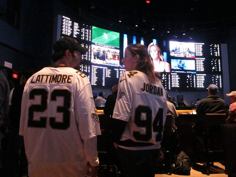 In this file photo, football fans wait for kickoff in the sports betting lounge at the Ocean Casino Resort in Atlantic City, N.J.