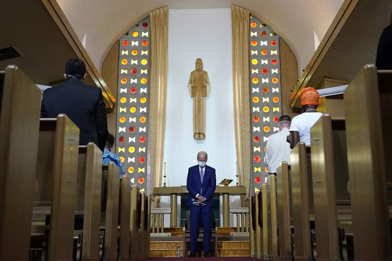 FILE - In this Thursday, Sept. 3, 2020 file photo, Democratic presidential candidate former Vice President Joe Biden bows his head in prayer at Grace Lutheran Church in Kenosha, Wis. Conservative evangelical Christians have proven some of Donald Trumps staunchest allies during his presidency. As his administration draws to a close, some of those backers are approaching President-elect Biden with skepticism, but not antagonism. (AP Photo/Carolyn Kaster)