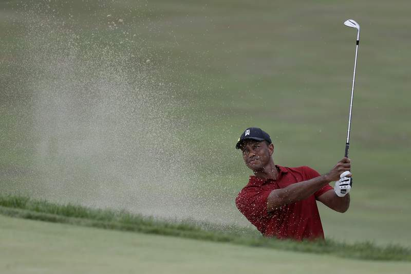 Tiger Woods hits from a bunker toward the 18th green during the final round of the Memorial golf tournament, Sunday, July 19, 2020, in Dublin, Ohio. (AP Photo/Darron Cummings)