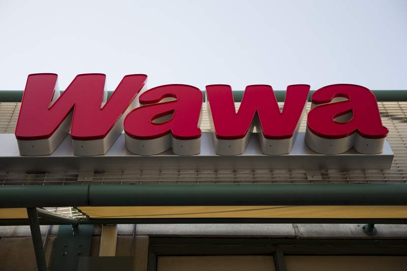 """FILE - This April 2, 2015 file photo shows a Wawa convenience store in Philadelphia. To celebrate its newest store opening in Delaware County, Pa., where the Kate Winslet-led crime drama """"Mare of Easttown"""" is set, Wawa is dedicating Thursday, June 10, 2021, as Mare of Easttown Day, an homage to the show that introduced the world to the coffee and hoagies Pennsylvanians have loved for years. (AP Photo/Matt Rourke, File)"""