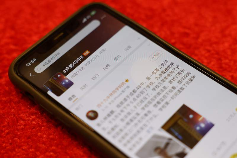 A Weibo page about the death of a student in Chengdu with 1.72 billion views is displayed on a mobile phone in Beijing on Thursday, May 13, 2021. The 16-year-old student's death has touched a nerve, becoming one of the most discussed topics on Chinese social media this week.(AP Photo/Ng Han Guan)