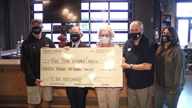 Farah & Farah present check for nearly $30,000 to Paws & Stripes program.