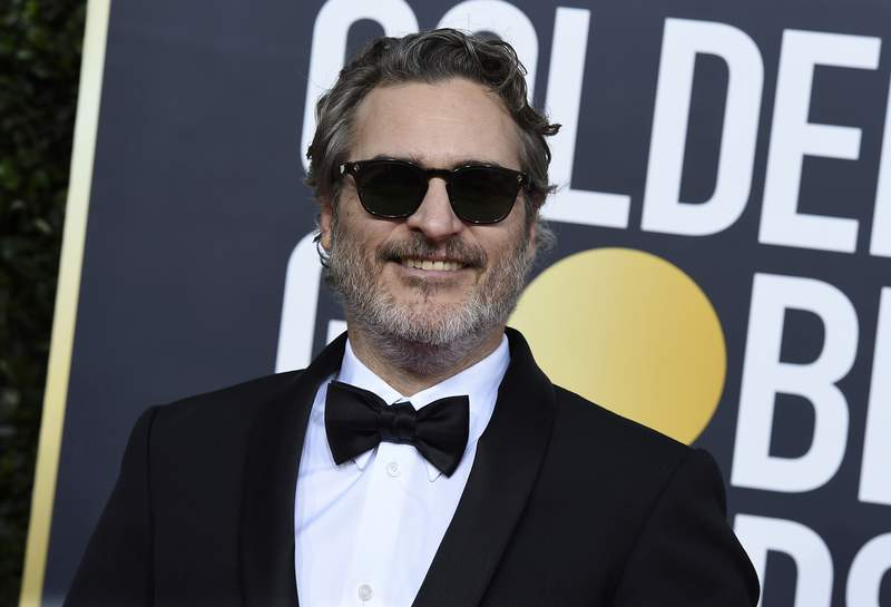 FILE - In this Sunday, Jan. 5, 2020 file photo, Joaquin Phoenix arrives at the 77th annual Golden Globe Awards at the Beverly Hilton Hotel on  in Beverly Hills, Calif. The film Joker has topped the nominations for the British Academy film awards announced on Tuesday Jan. 7, 2020. The awards will be announced at a gala event hosted by Graham Norton on February 2. (Photo by Jordan Strauss/Invision/AP, File)