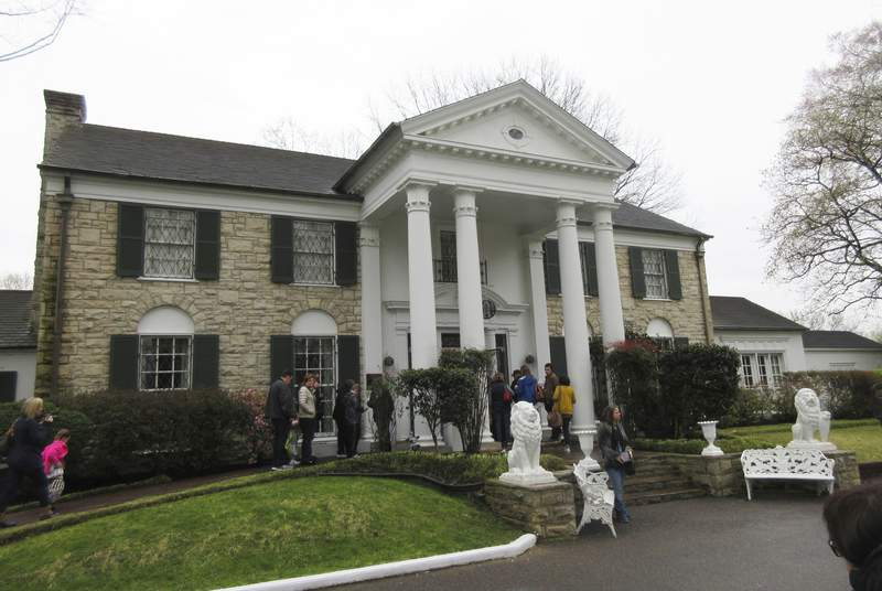 FILE - In this March 13, 2017, file photo, visitors get ready to tour Graceland in Memphis, Tenn. Elvis Presley's Graceland is closing in response to the coronavirus outbreak, Friday, March 20, 2020.(AP Photo/Beth J. Harpaz)