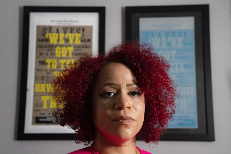 Nikole Hannah-Jones stands for a portrait at her home in the Brooklyn borough of New York, Tuesday, July 6, 2021. Hannah-Jones says she will not teach at the University of North Carolina at Chapel Hill following an extended fight over tenure. (AP Photo/John Minchillo)