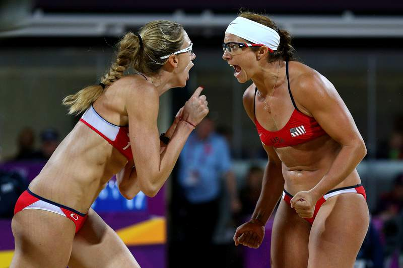 Kerri Walsh Jennings (L) and Misty May-Treanor of the United States celebrates winning the Gold medal in the Women's Beach Volleyball Gold medal match against the United States on Day 12 of the London 2012 Olympic Games at the Horse Guard's Parade on August 8, 2012 in London, England. (Photo by Cameron Spencer/Getty Images)