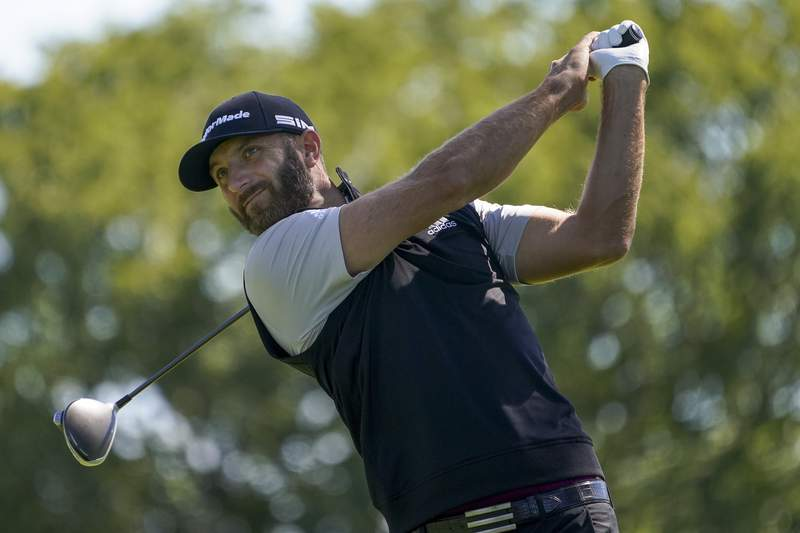 FILE - Dustin Johnson, of the United States, plays his shot from the fourth tee during the third round of the US Open Golf Championship, Saturday, Sept. 19, 2020, in Mamaroneck, N.Y. (AP Photo/John Minchillo)