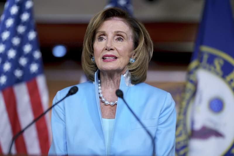 FILE - In this Aug. 6, 2021, file photo, Speaker of the House Nancy Pelosi, D-Calif., meets with reporters at the Capitol in Washington. The campaign organization aiming to maintain Democratic control of the House in the 2022midterm racesraised $10 million last month, its best August haul ever during a year without a national election. The Democratic Congressional Campaign Committee says that nearly 250,000 grassroots donors provided $6.6 million, accounting for two-thirds of its monthly total, according to numbers shared with The Associated Press before a public filing deadline.That total included transfers worthmore than$1 million from other Democratic campaign accounts. The largest, from Pelosi, was worthnearly $800,000. (AP Photo/J. Scott Applewhite, File)