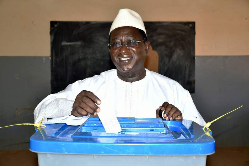 FILE - This Sunday, Aug. 12, 2018 file photo released by the Union for the Republic and Democracy party shows Soumaila Cisse, opposition presidential candidate, casting his ballot during the presidential second round election in Niafunke, Mali. The leader of Mali's political opposition and members of his campaign team have been taken hostage by unidentified gunmen in the north, the spokesman for his political party said Thursday, March 26, 2020. (Boubacar Sada Sissoko/Union for the Republic and Democracy via AP, File)