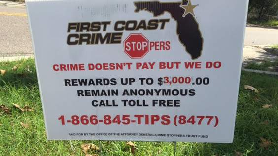 First Coast Crime Stoppers sign place in the yard of a homicide victim.