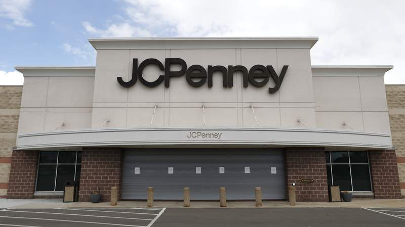 FILE - In this May 8, 2020, file photo, a parking lot at a JC Penney store is empty in Roseville, Mich. J.C. Penney is on course to emerge from bankruptcy by Thanksgiving, after a U.S. bankruptcy court approved the sale of the ailing retailer to two of the nation's largest landlords and its primary lenders. Penneys financing agreement expires on Nov. 16, and the sale had to close by Nov. 20, to avoid going out of business. (AP Photo/Paul Sancya, File)