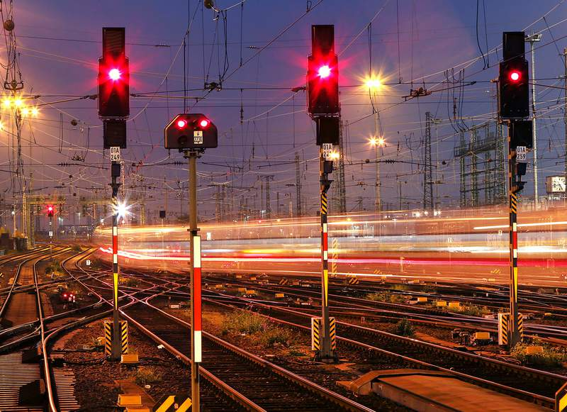 FILE - In this Wednesday, Oct. 17, 2018 file photo a train leaves at night the main train station in Frankfurt, Germany. Four European rail companies announced Tuesday they plan to boost the continents network of night train connections by reviving routes that were dropped several years ago for cost reasons. (AP Photo/Michael Probst, File)