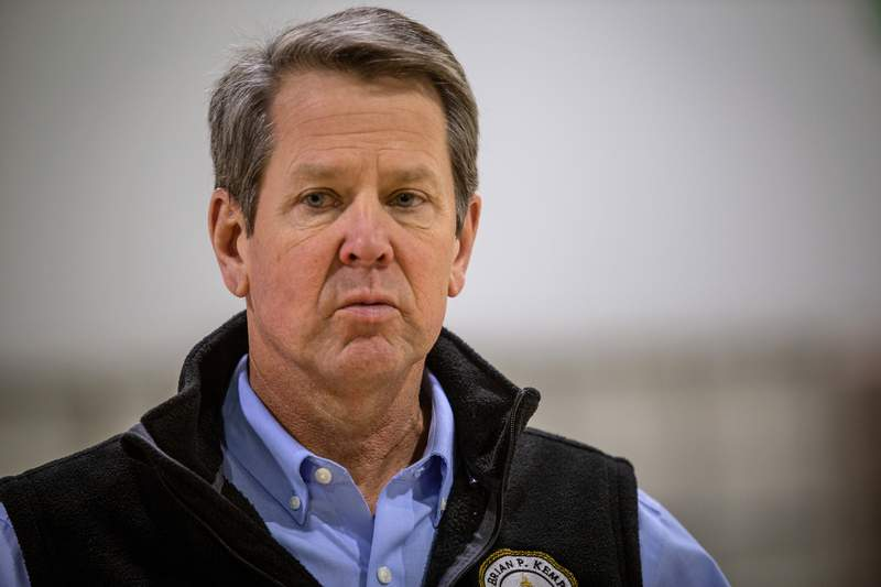FILE - In this April 16, 2020, file photo, Georgia Gov. Brian Kemp listens to a question from the press during a tour of a temporary hospital at the Georgia World Congress Center in Atlanta. Kemp plans to have many of his states businesses up and running again as soon as Friday, April 24. (AP Photo/Ron Harris, Pool, File)