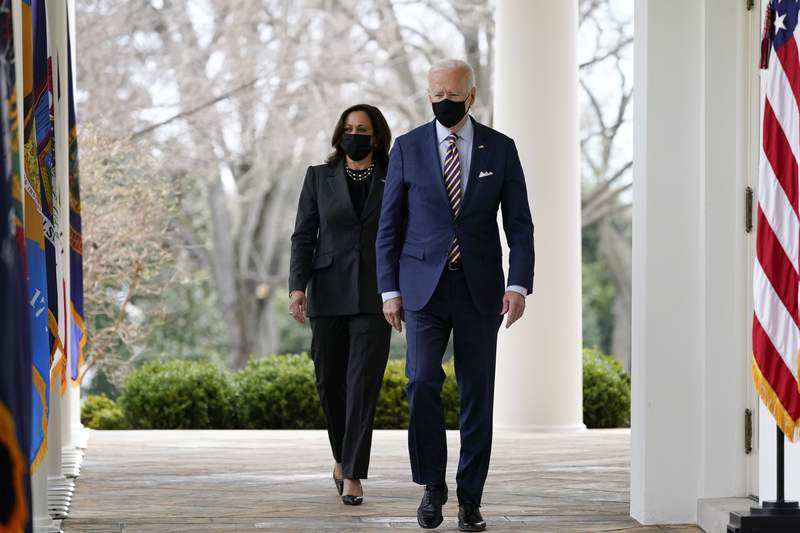 FILE - In this March 12, 2021, file photo, President Joe Biden and Vice President Kamala Harris walk along the White House colonnade as they arrive to speak in the Rose Garden in Washington. Biden and Harris plan to meet with Asian American community leaders in Georgia in the wake of the deadly shootings at three Atlanta-area massage parlors, the White House announced Thursday, March 18. (AP Photo/Alex Brandon, File)