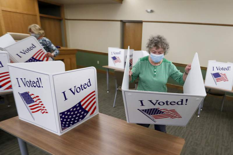 Marty Goetz prepares voting screens as they start to set up a polling place. (File photo)