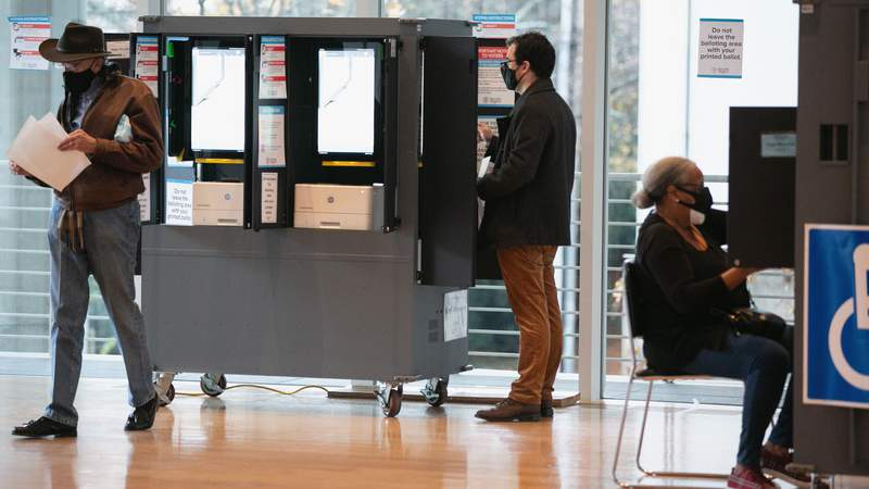 Voters cast ballots on first day of in-person voting in two U.S. Senate races.
