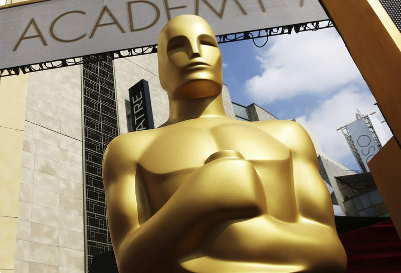 FILE - In this Feb. 21, 2015 file photo, an Oscar statue appears outside the Dolby Theatre for the 87th Academy Awards in Los Angeles. The 93rd Oscars will be held on April 25. (Photo by Matt Sayles/Invision/AP, File)
