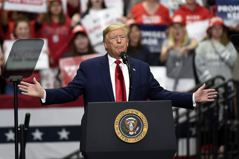 FILE - In this March 2, 2020, file photo, President Donald Trump speaks during a campaign rally in Charlotte, N.C. Trump is resuming in-person fundraising events after a three-month hiatus as his campaign works to maintain a cash advantage over Democrat Joe Biden that it believes is vital to victory in November.  (AP Photo/Mike McCarn, File)