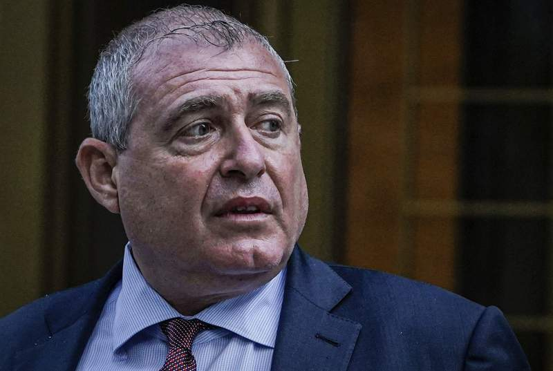 FILE - In this Tuesday, Oct. 12, 2021, Lev Parnas, an associate of Rudy Giuliani, leaves federal court in New York. Lawyers opened Parnas' trial on Wednesday with plenty of talk about $1 million from a Russian financier that prosecutors contend was aimed at illegally influencing U.S. politicians, but there was little mention of Giuliani and other prominent political figures whose names will arise later in the trial.  (AP Photo/Seth Wenig, File)