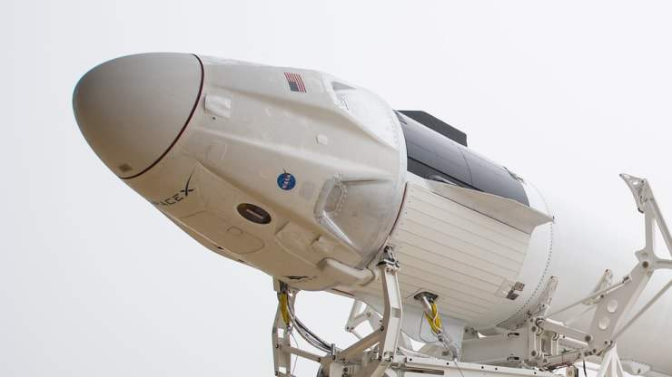 A SpaceX Falcon 9 rocket with the company's Crew Dragon spacecraft onboard is rolled out for the Demo-1 mission in March.