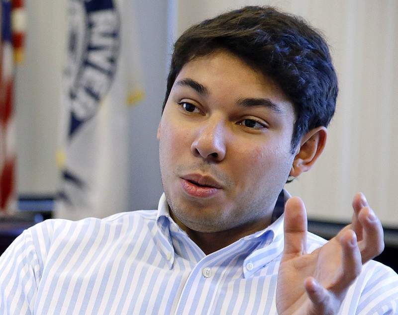 FILE - In this Jan. 6, 2016, file photo, Fall River Mayor Jasiel Correia talks in his city hall office in Fall River, Mass. Correia, first elected at the age of 23 by touting himself as a successful entrepreneur, was convicted Friday, May 14, 2021, of stealing money from investors in his start-up to bankroll his lavish lifestyle and soliciting bribes from marijuana vendors who wanted to operate in the struggling mill city. (  (AP Photo/Stephan Savoia, File)