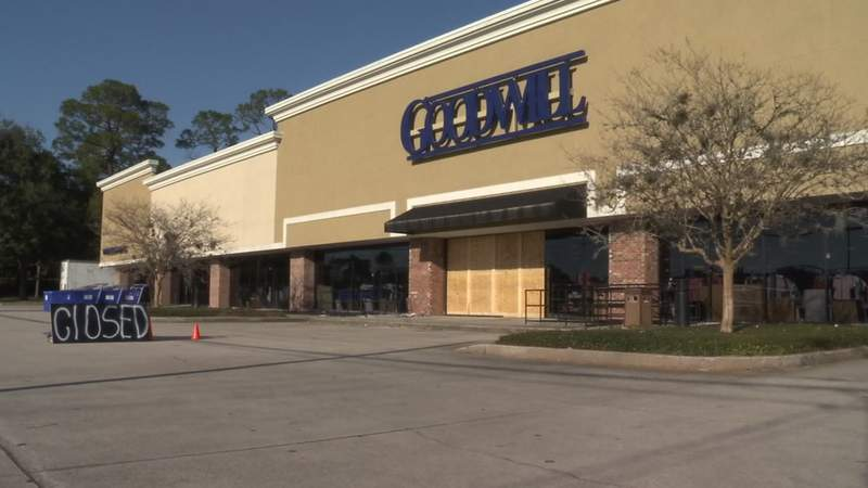 """On Sunday, the Southside Goodwill store was boarded up and there was a """"closed"""" sign in the parking lot."""