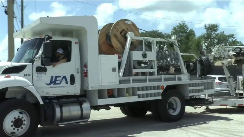 FILE - Dozens of JEA trucks, deployed to Louisiana in preparation of Hurricane Laura