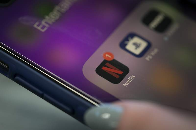 FILE - This Oct. 8, 2019, file photo shows the Netflix app on an iPhone in New York. Netflix reports financial results Tuesday, Jan. 21, 2020. (AP Photo/Jenny Kane, File)
