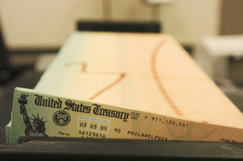 FILE - In this Feb. 11, 2005 file photo, trays of printed social security checks wait to be mailed from the U.S. Treasury's Financial Management services facility in Philadelphia. The government says the financial condition of the governments two biggest benefit programs remains shaky. It indicates that Medicare is expected to become insolvent in just six years while Social Security will be unable to pay full benefits starting in 2035.  (AP Photo/Bradley C. Bower, File)