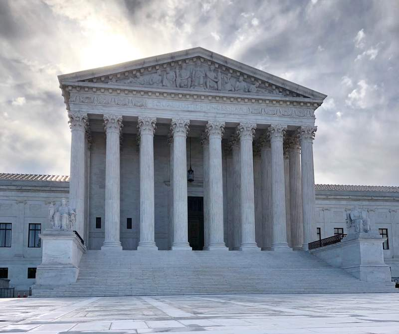 The rising sun shines over the Supreme Court building on Capitol Hill in Washington, Monday morning, May 11, 2020. (AP Photos/Mark Sherman)