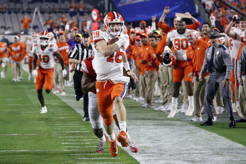 FILE - Clemson quarterback Trevor Lawrence runs for a touchdown against Ohio State during the first half of the Fiesta Bowl NCAA college football playoff semifinal in Glendale, Ariz., Saturday, Dec. 28, 2019, in Glendale, Ariz. (AP Photo/Ross D. Franklin)