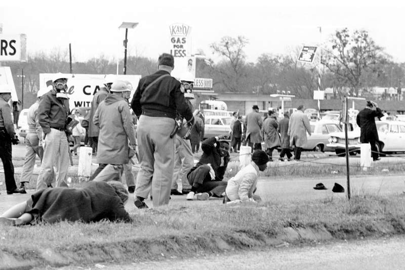 FILE - In this March 7, 1965, file photo, civil rights demonstrators struggle on the ground as state troopers break up a march in Selma, Ala. The world knows the names of John Lewis and a few more of the voting rights demonstrators who walked across Selma's Edmund Pettus Bridge in 1965 only to be attacked by Alabama state troopers on a day that came to be called Bloody Sunday. A new project aims to identify more of the hundreds of people who were involved in the protest. (AP Photo/File)