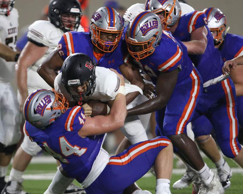 Bishop Kenny RB Cayden Jaegar (36) is brought down by Bolles defenders during a scrimmage at Skinner-Barco Stadium on Sept. 4.