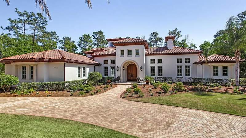Court records show this home on Royal Troon Lane was sold earlier this month to a trust in the name of Urban Meyer's wife.