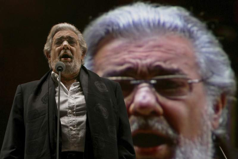 FILE - In this Dec. 19, 2009 file photo, Placido Domingo performs during a sound check prior to a free concert in Mexico City. Domingo's name has been removed from the Washington National Opera's young artist program in light of recent developments, the opera house announced Tuesday, March 3, 2020. (AP Photo/Marco Ugarte, File)