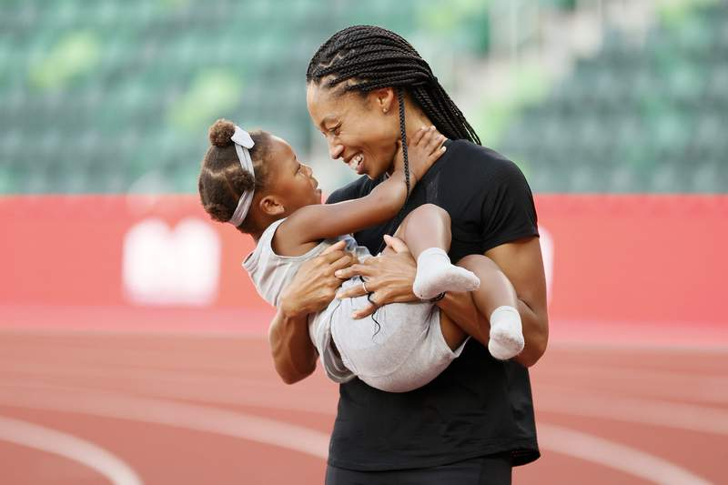Allyson Felix celebrates with her daughter Camryn after day nine of the U.S. Olympic Track & Field Team Trials at Hayward Field on June 26, 2021 in Eugene, Oregon.