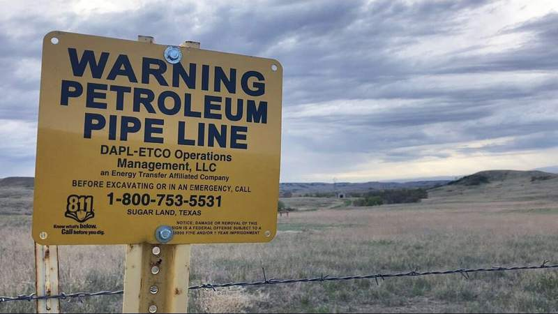 A sign for the Dakota Access Pipeline is seen north of Cannonball, N.D. and the Standing Rock Reservation on Thursday May 20, 2021. (AP Photo/Matthew Brown)
