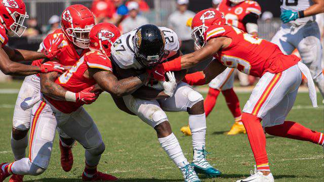 Jaguars running back Leonard Fournette is wrapped up during Sunday's game against the Chiefs.