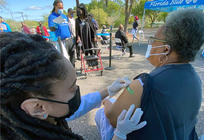 Photo of vaccinations given Friday in the parking lot of the Harvey's story on Moncrief Road.