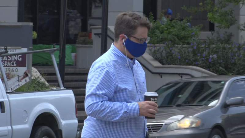 The county surrounding the state's capital city is the latest jurisdiction to mandate face masks for indoor public places, but a lawsuit is already planned that could set a precedent for challenging similar orders around the state.